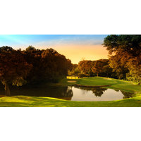 The fifth hole of the East Course of Bear Creek Golf Club in Dallas challenges golfers with a water-carry to the green.