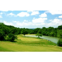 The par-5 seventh hole at Crystal Falls Golf Course is one of the trickiest, with water surrounding the green.