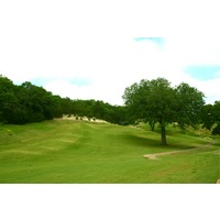 Crystal Falls Golf Course's par-4 third hole plays to an elevated green.
