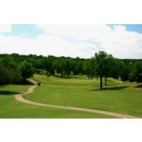 The par-4 sixth hole at Crystal Falls Golf Course plays 432 yards from the championship tees.