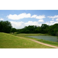 Crystal Falls Golf Course's par-3 eighth hole is played over water.