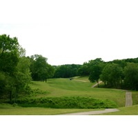The narrow, uphill 10th hole at Crystal Falls Golf Course plays 346 yards from the championship tees.
