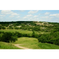 Crystal Falls Golf Course's par-3 11th hole plays steeply downhill and is 192 yards from the championship tees.