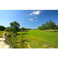 The par-5 10th hole at Vaaler Creek Golf Club features a split fairway off the tee and then an uphill slope to an elevated green.