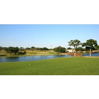 A long carry is required over water at Vaaler Creek Golf Club's finishing hole.