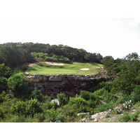The par-5 forth at River Place Country Club features a carry on the approach shot to a dramatic green sitting atop rock.