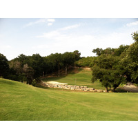 The sixth hole at River Place Country Club is a par 3 that features water in front of the green.