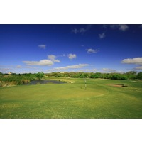 The fourth hole on the Creeks nine at Hill Country Golf Club is a long par 5 guarded by water on the right side.