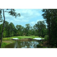 The first hole on The Needler short course at Whispering Pines Golf Club was built around a natural setting of ponds and creeks.