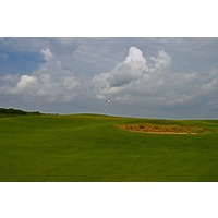 The first hole at Palmilla Beach Golf Club in Port Aransas is a slight dogleg-left par 4 to an elevated green.