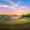 A splendid sunrise view of a hole at Pebble Creek Country Club.
