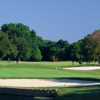 A view of a green surrounded by bunkers at Pecan Valley Golf Course.