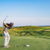 Golfer teeing off at Palmilla Beach Golf Club
