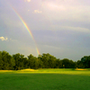 A view of a rainbow over the 7th green at Sunset Golf Club