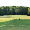 A view of a green protected by bunkers at Pine Forest Country Club