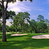 A view of green protected by bunkers at Houston Country Club