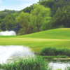 A view over the water of a green at Lost Creek Country Club.