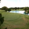 A view of a green with water coming into play at Lone Star Golf Course