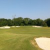A view of a hole surrounded by a collection of bunkers at Indian Creek Golf Course
