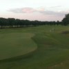 A view of a green and a fairway at Indian Creek Golf Course