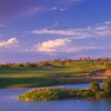 A view over the water of hole #1 from Butterfield Trail Golf Club