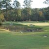A view of a green with water coming into play at Rayburn Country Resort