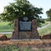 A view of the entrance sign and a hole at Brownwood Country Club.