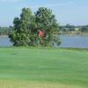 A view of a hole with water in background at P.A.R. Country Club.