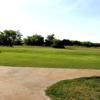 A sunny day view of a hole at Perry Country Club.