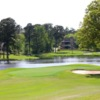 A view of a green surrounded by water at Crown Colony Country Club.