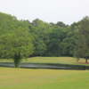 A view of a green protected by a pond at Lufkin Country Club.