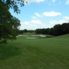 A view of a green protected by bunkers at Mill Creek Golf Club