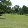 A sunny day view of a green at Rolling Oaks Golf Club.