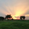 A sunset view of a hole at Gaines County Golf Course.