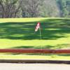 A sunny day view of a green at Hilltop Country Club.