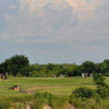 A sunny day view of a tee at Quanah Country Club.