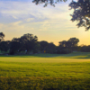 A sunset view of a green at Bent Tree Country Club.