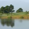 A view of a green with water and bunkers coming into play at Cypress Lakes Golf Club.