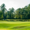 A sunny day view of a hole at The Needler Course from Whispering Pines Golf Club.