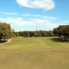 A sunny summer day view of a fairway at Luna Vista Golf Course.
